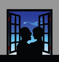 couple silhouette front of window vector image