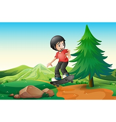 A young boy skateboarding at the hilltop vector image vector image