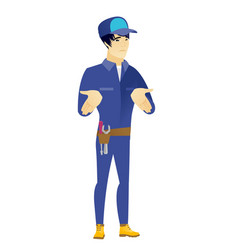 asian confused mechanic shrugging shoulders vector image vector image