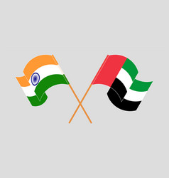 Crossed and waving flags india and united vector
