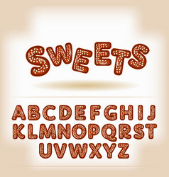 Comic cartoon chocolate nuts candy style alphabet vector image