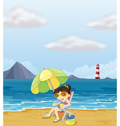 A girl relaxing at the beach vector image