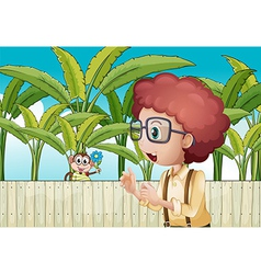 A boy and monkey with flower near the wooden vector
