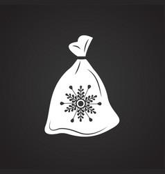 Christmas gift bag on black background vector