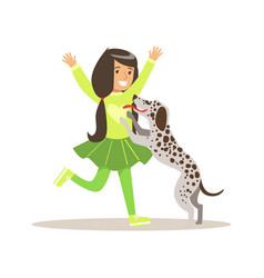 Smiling girl playing with her dalmatian dog vector
