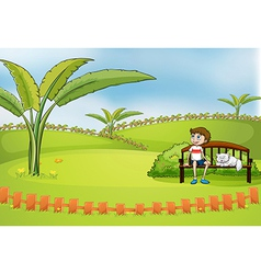 A boy sitting in the park with his pet vector image vector image