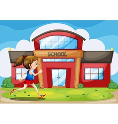 A girl in front of the school building vector
