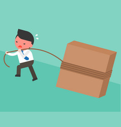 businessman pulling block with rope to road slope vector image