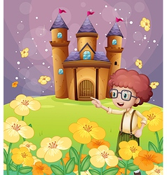 A boy pointing near the flowers in the hill with a vector