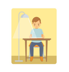 a young man reading the book on chair home vector image