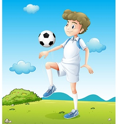 A boy playing soccer during daytime vector image vector image