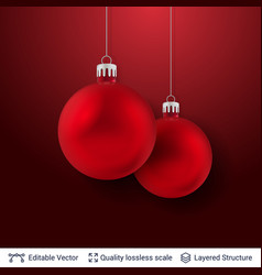 two red christmas balls on dark background vector image