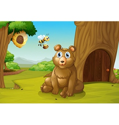 A bear and a bee near a treehouse vector image vector image