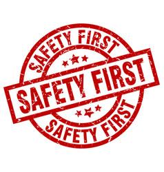 Safety first round red grunge stamp vector