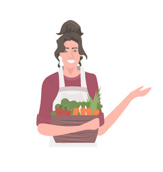 beautiful woman gardener holding basket with fresh vector image