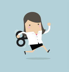 Businesswoman running with wind-up key vector