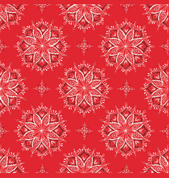 mandala with red floral pattern on red background vector image