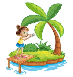 A girl taking photos in the island vector image
