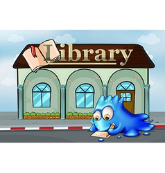 A monster writing in front of the library vector image