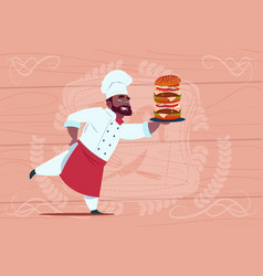 african american chef cook hold big burger smiling vector image