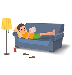 Young man lying on the couch with a tablet vector image