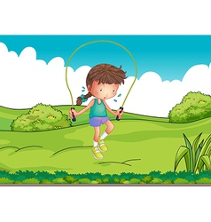 A girl playing jumping rope at the top of the hill vector image vector image