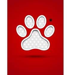 Cut out red card with animal footprint vector image
