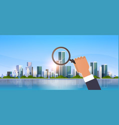 businessman hand holding magnifying glass search vector image