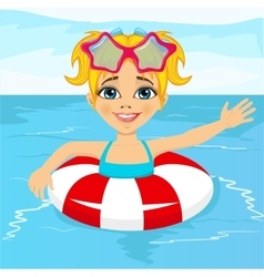 little girl swimming in pool with inflatable ring vector image