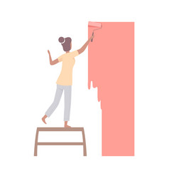 woman paints the wall with roller in coral flat vector image