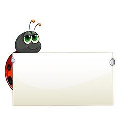 A ladybug holding an empty signage vector image