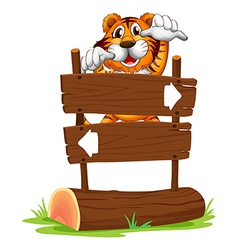 A tiger in a scary mood at the back of a signboard vector image vector image