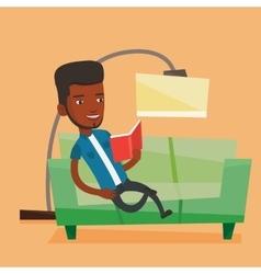 Man reading book on sofa vector
