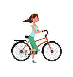 young woman riding a bike with headphones active vector image