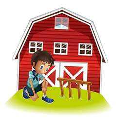 A sad boy in front of the barnhouse vector image