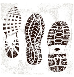 A high detailed set three grunged shoe tracks vector
