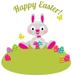 Easter bunny and colored eggs in the grass vector