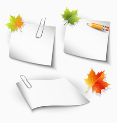 Paper clips and sheets pencil and autumn leaves vector