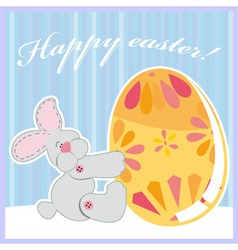 cute Easter bunny holding egg vector image vector image