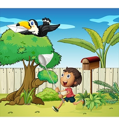 A boy catching the bird with an envelope vector