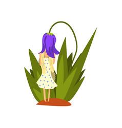 cute little girl standing under the bell flower vector image