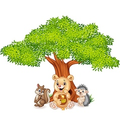 Cartoon funny animal on the tree vector image