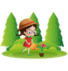 Girl watering the plants in the garden vector