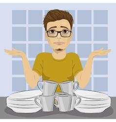 Sad man and dirty dishes pile needing washing up vector