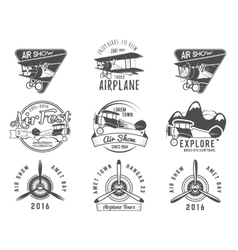 Vintage airplane emblems Biplane labels Retro vector image