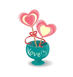 Two lollipop red ribbon entwined in a green vase vector image