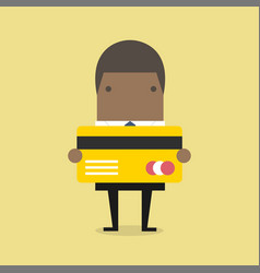 african businessman holding a credit card vector image