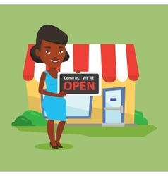 Female shop owner holding open signboard vector