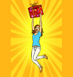 joyful young woman jumping up with a gift vector image