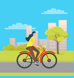 woman riding on bicycle in green city park trees vector image
